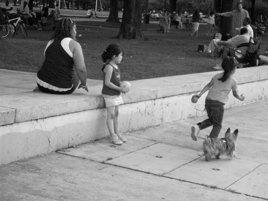 Girls play in an empty fountain in Flushing Meadows